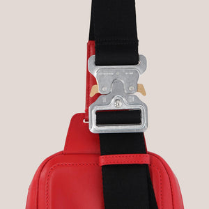 1017 Alyx 9SM - Small Crossbody Bag in Red, detailed view of rollercoaster buckle, available at LCD.