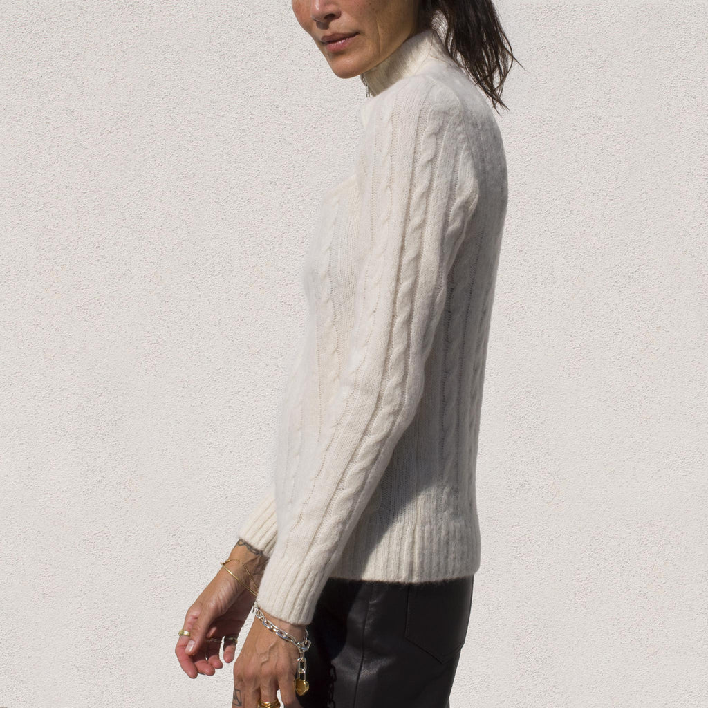 Ganni - Cutout Cable Knit Sweater, side view.
