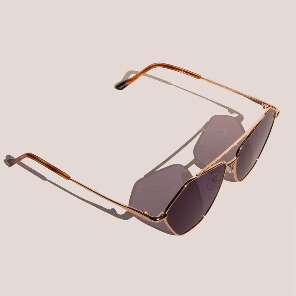 Le Specs - Dweller Sunglasses - Bright Gold, angled view, available at LCD.