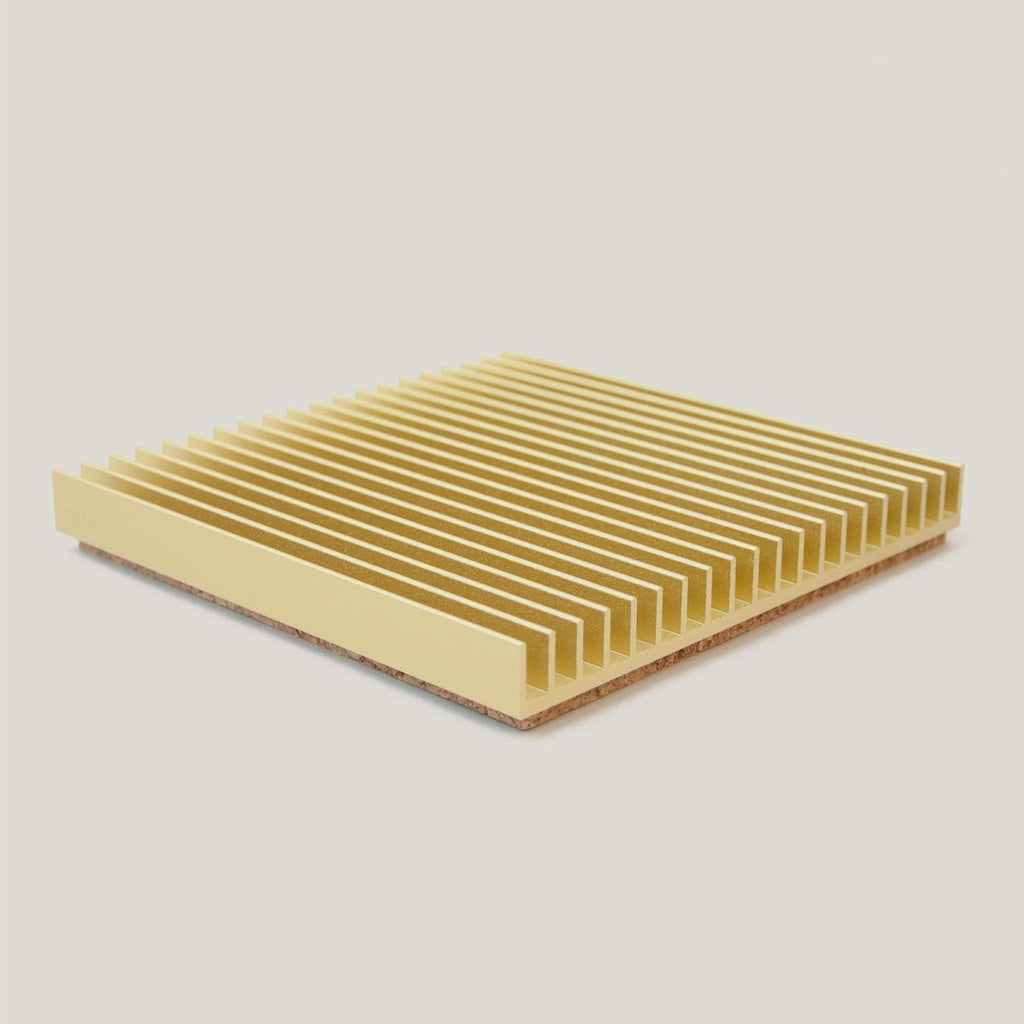 Souda - Fin Trivet in gold, angled view.