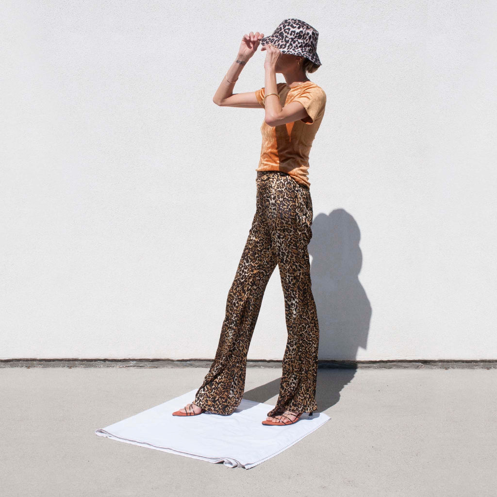 Priscavera - Fitted Flare Pants - Leopard, angled view.