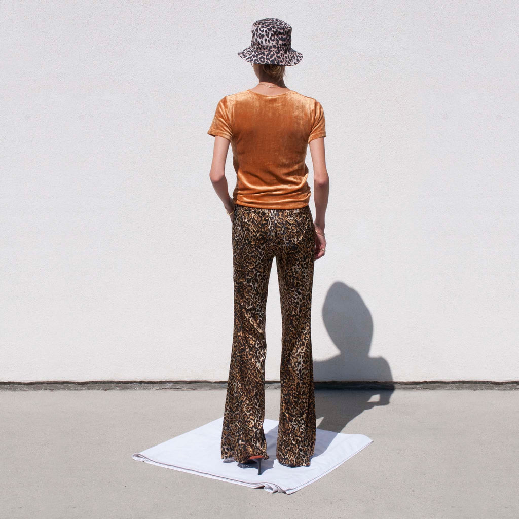 Priscavera - Fitted Flare Pants - Leopard, back view.