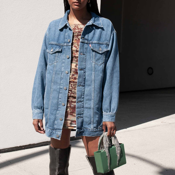 GANNI x Levi's Oversized Denim Dress, worn as a jacket, front view.