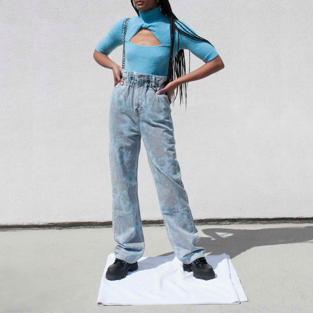 GANNI x Levi's Printed High Waisted Jeans - Light Denim, front view.