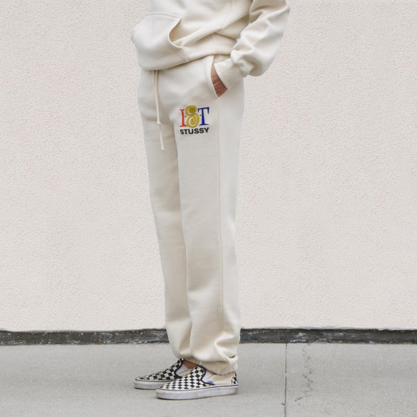 Stussy - IST Sweatpant - Cement, angled view, available at LCD.
