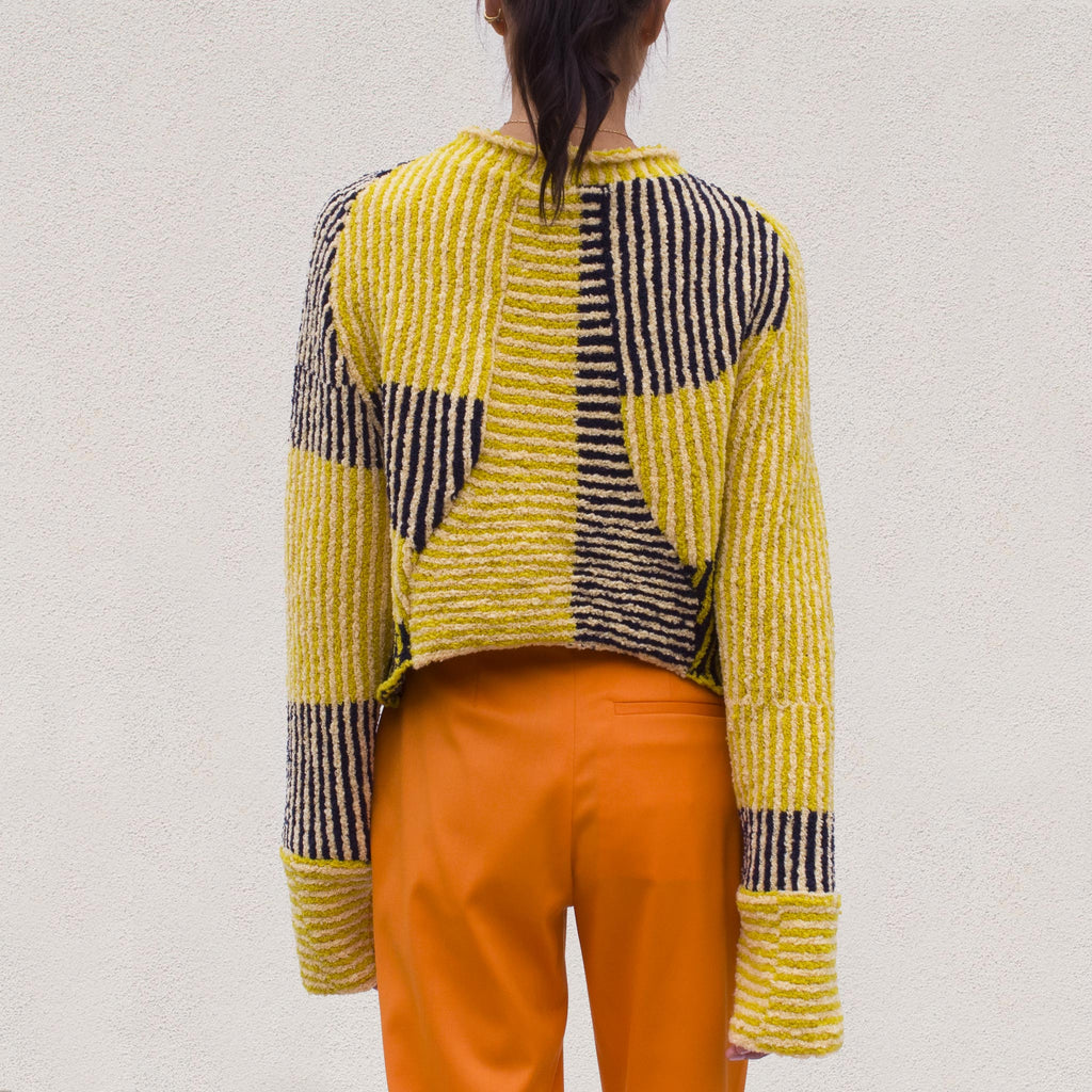 Eckhaus Latta - Jerome Dolman Sweater in Tuscan Sun, back view.
