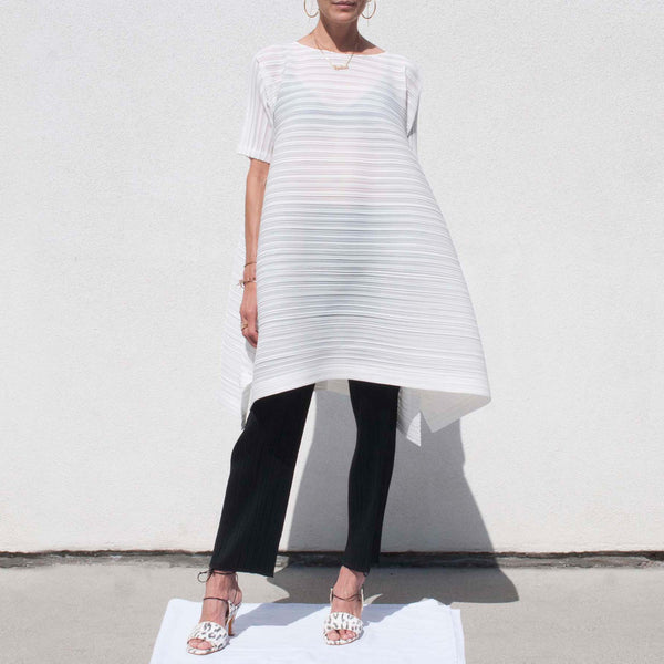 Pleats Please - Komorebi Bouncy Dress, a white horizontally pleated voluminous dress that ends at the knees.
