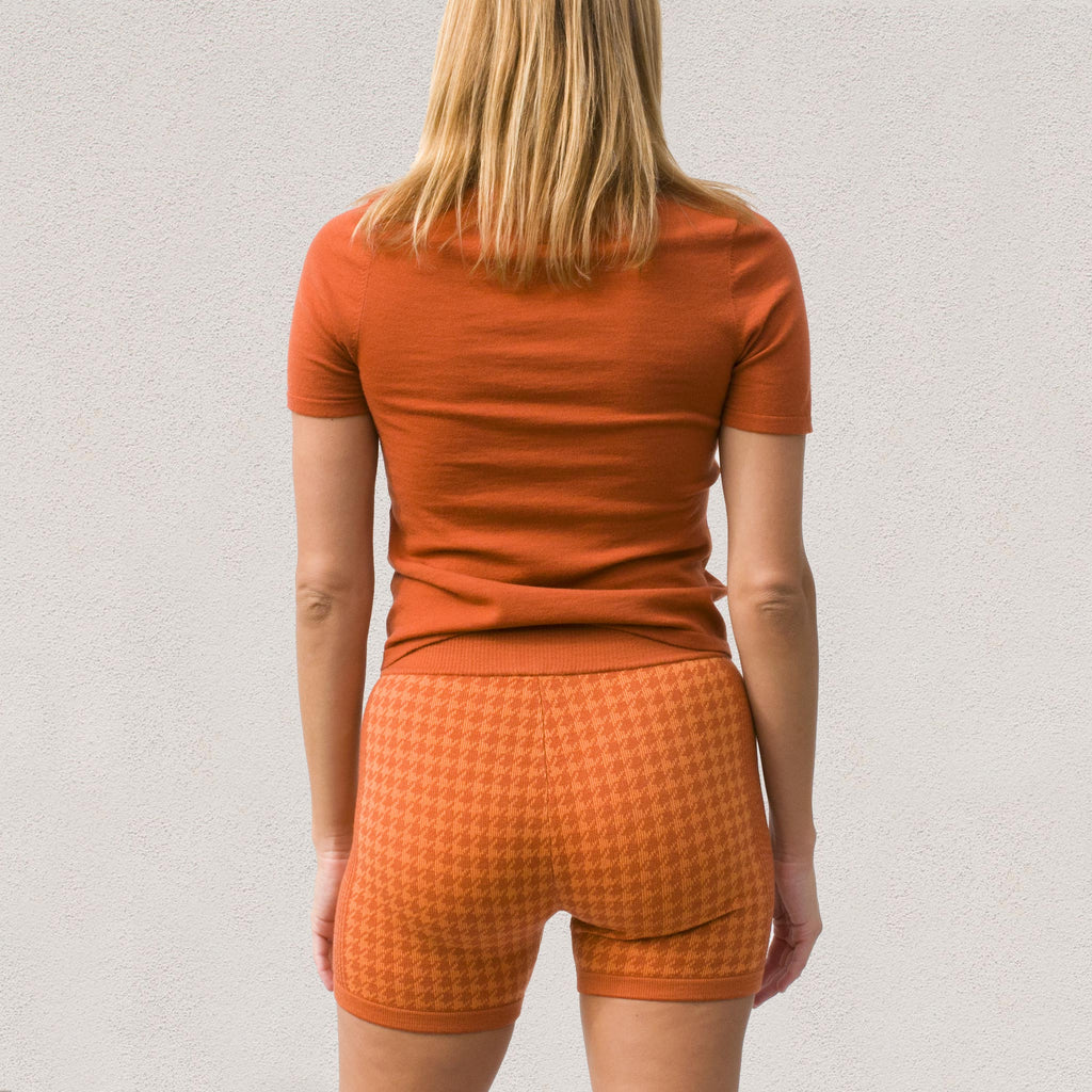 Nagnata - Merino Trash Tee in Rust / Orange, back view.