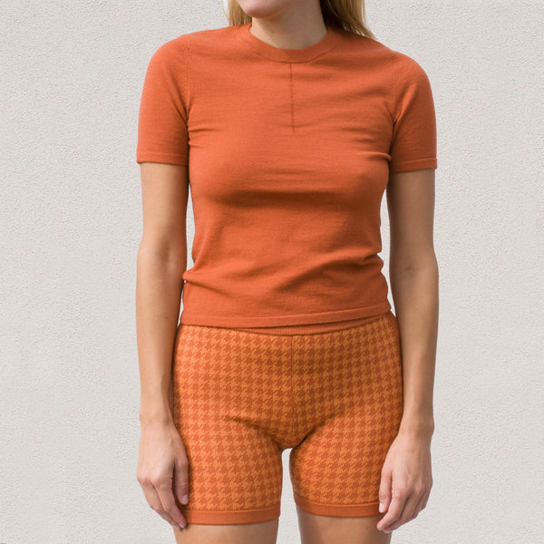 Nagnata - Merino Trash Tee in Rust / Orange, front view.