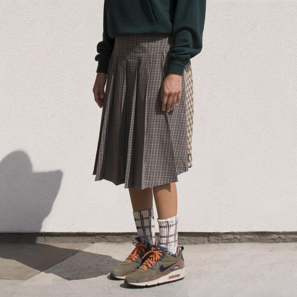 Stussy - Mix Plaid Pleated Skirt, angled view.