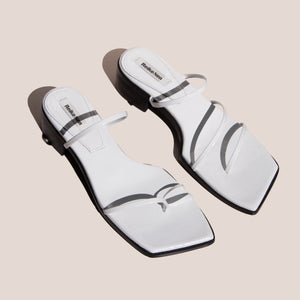 Reike Nen - Odd Pair Flat Sandals, angled view, available at LCD.