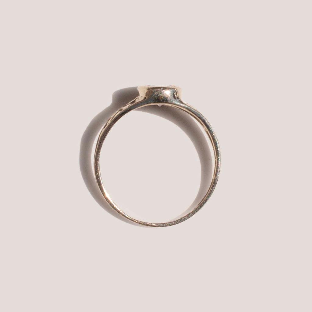 Dela Gold, Oval Stone Pinky Ring, available at LCD.