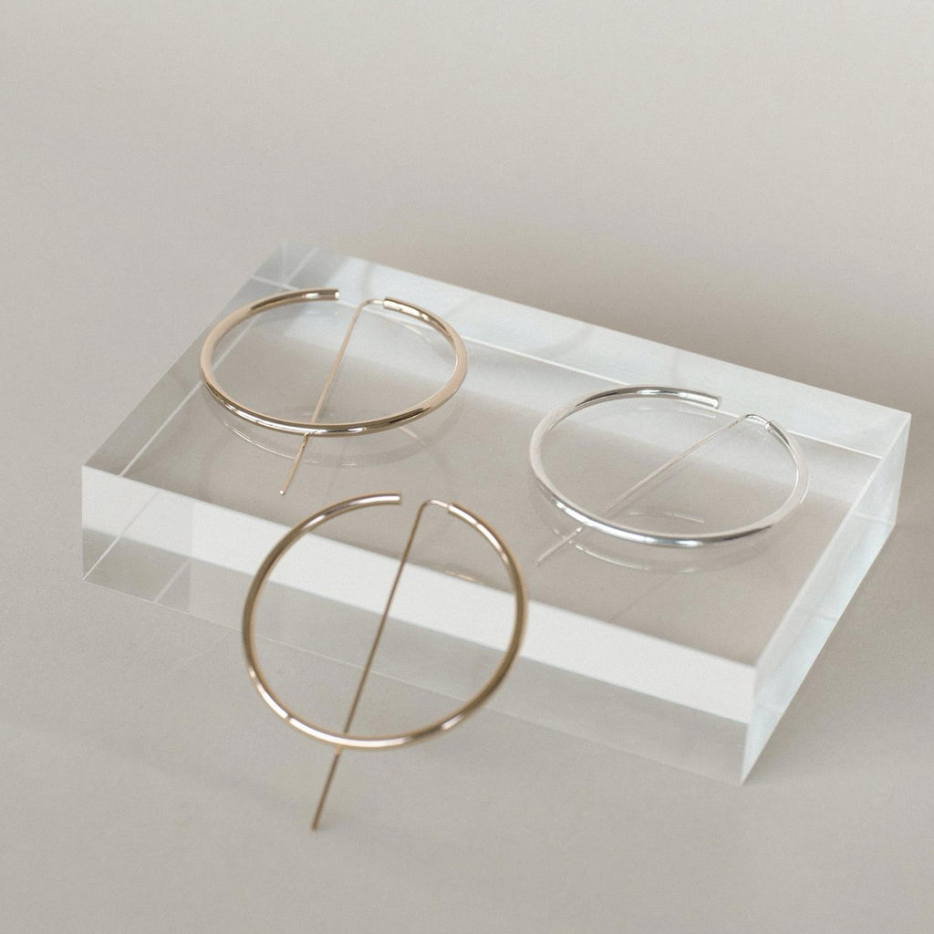 Jaclyn Moran - Oversized Hoop & Post Earrings in Rose Gold, Yellow Gold, and Sterling Silver.