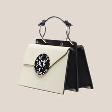 Load image into Gallery viewer, Danse Lente - Phoebe Bis Leather Bag - Dove/Black, angled view, available at LCD.