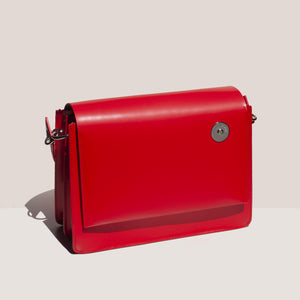 Kara - Pinch Shoulder Bag in Red, angled view, available at LCD.
