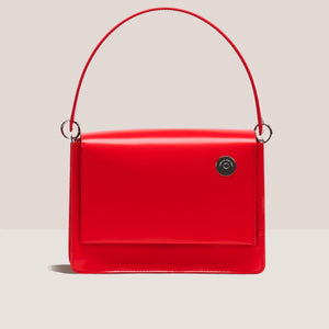 Kara - Pinch Shoulder Bag in Red, front view, available at LCD.