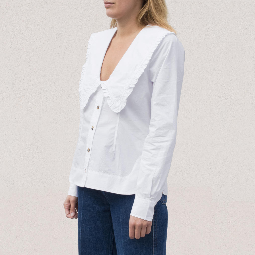 Ganni - Poplin V-Neck Shirt - White, angled view.