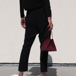 Roucha - Pouch Pant in Black, back view, available at LCD.