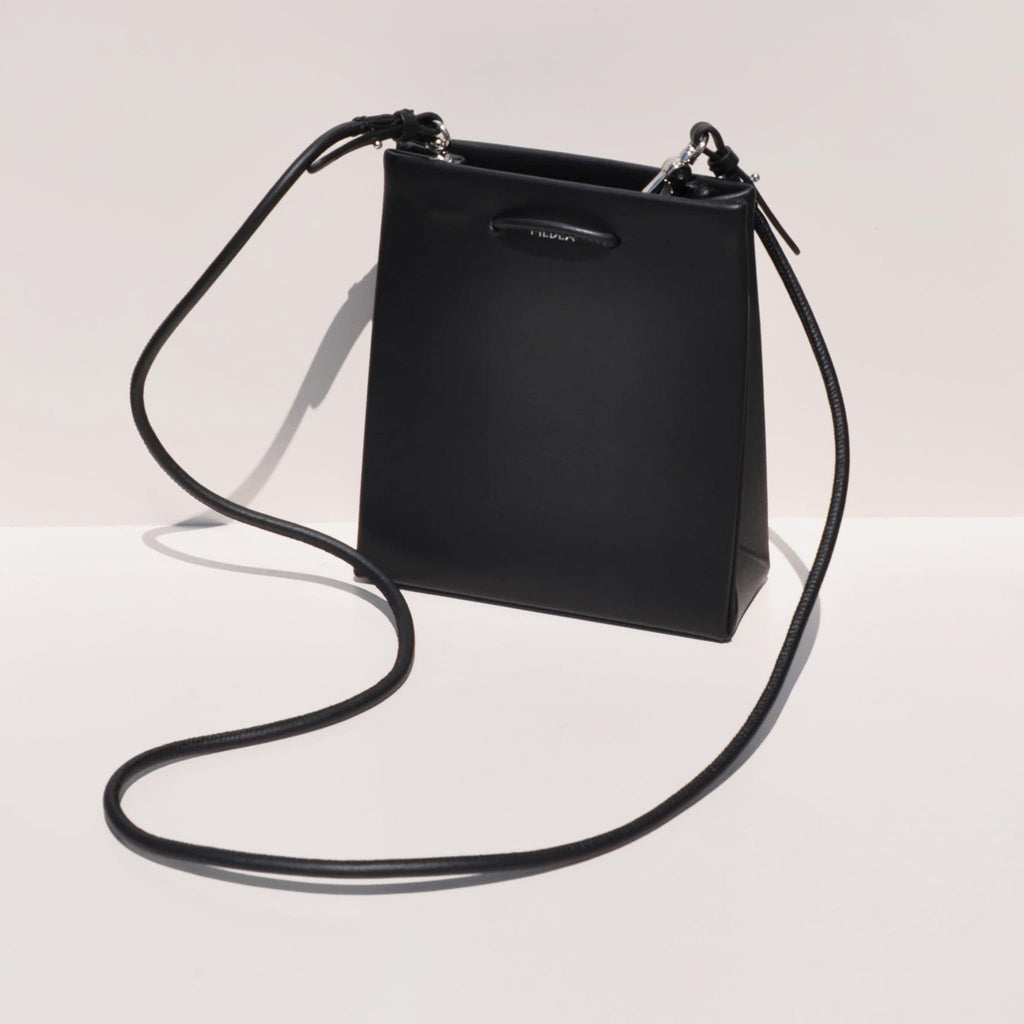 Medea - Prima Short Bag in black, photo showing long straps.