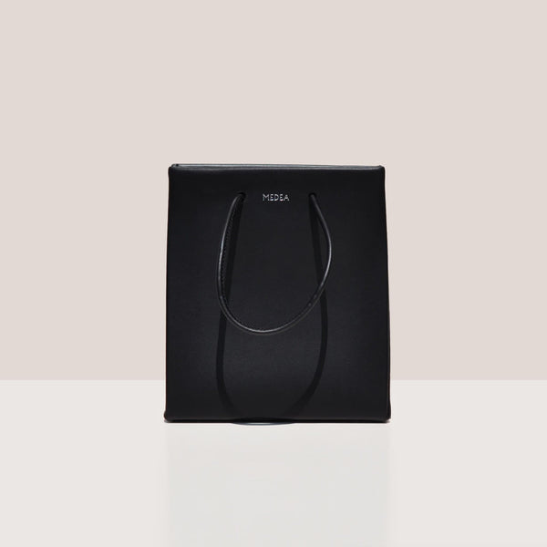 Medea - Prima Short Bag in black, frontal photo.