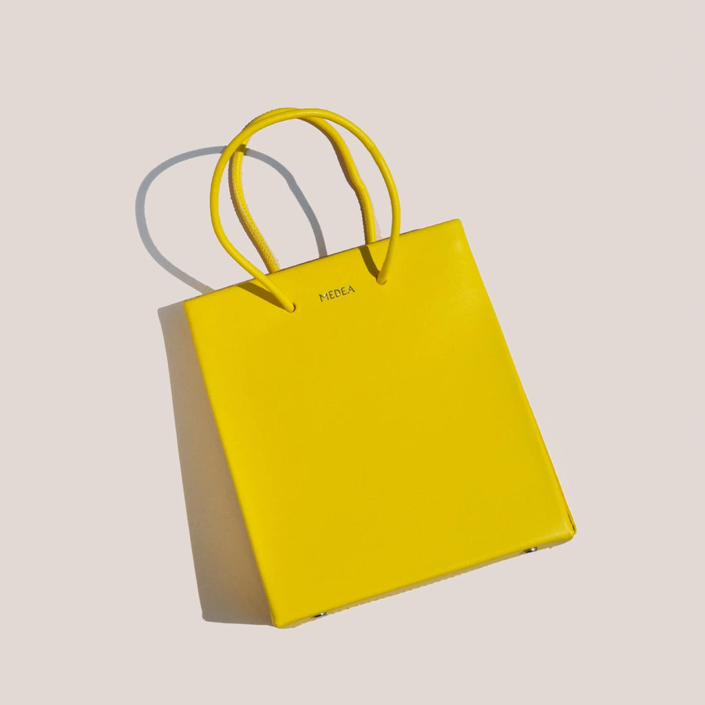 Medea - Prima Short Bag in Safety Yellow, front view, available at LCD.