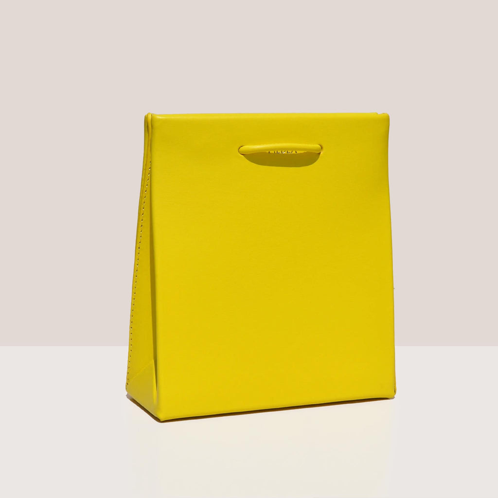 Medea - Prima Short Bag in Safety Yellow, angled view, available at LCD.