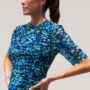 Ganni - Printed Mesh Ruched Dress in Azure Blue, angled view, available at LCD.