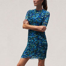 Load image into Gallery viewer, Ganni - Printed Mesh Ruched Dress in Azure Blue, angled view, available at LCD.