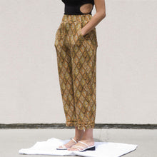 Load image into Gallery viewer, Nanushka - Selah Pants, angled view, available at LCD.