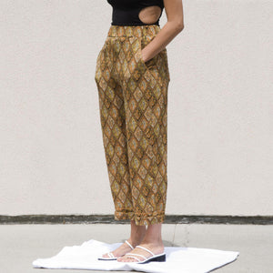 Nanushka - Selah Pants, angled view, available at LCD.
