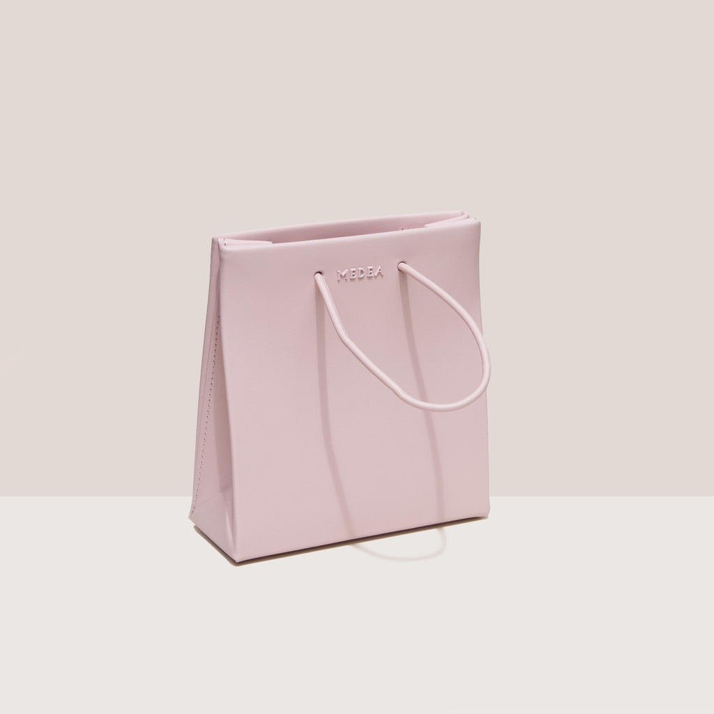 Medea - Medea Short Bag - Rosepink, angled view, available at LCD.