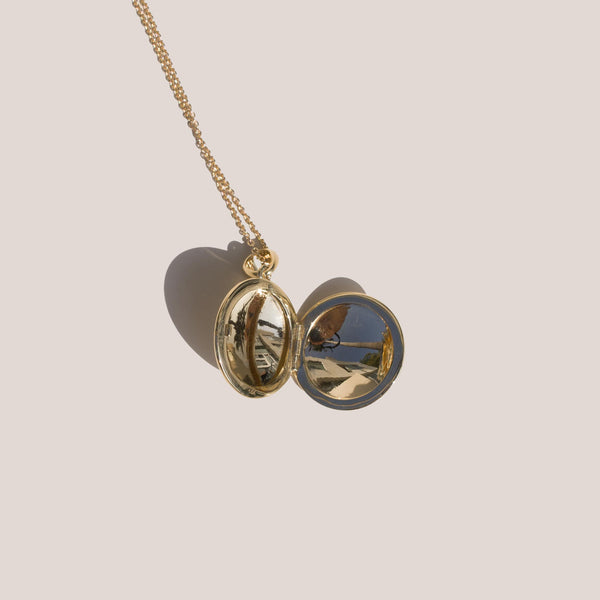 J. Hannah Signature Locket in 14K yellow gold.
