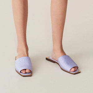 Ganni - Slipper Sandals, angled view, available at LCD.