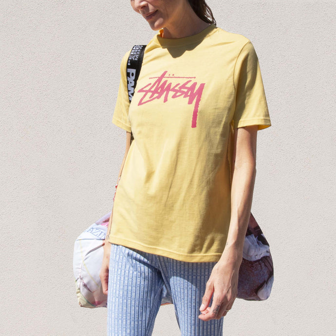 Stussy - Stock Tee - Yellow, angled view, available at LCD.