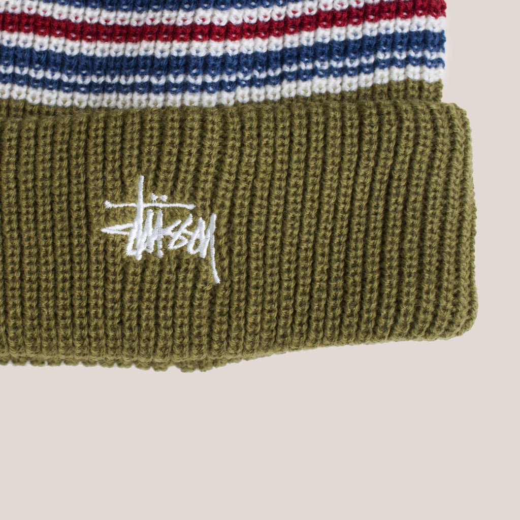 Stussy - Stripe Cuff Beanie - Olive, detailed view of front logo.