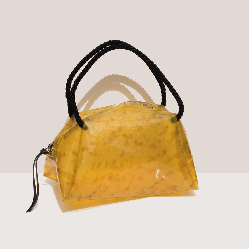 Maryam Nassir Zadeh - Sun Purse - Golden Marble, angled view, available at LCD.