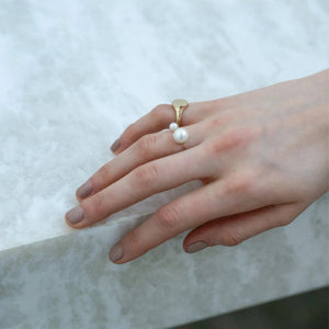 Gabriela Artigas - Asymmetric Suspended Pearl Ring on the hand, available at LCD.