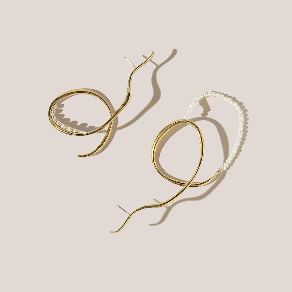 Faris - Vinea Perla Earrings, a mismatched thin hanging pair of earrings.