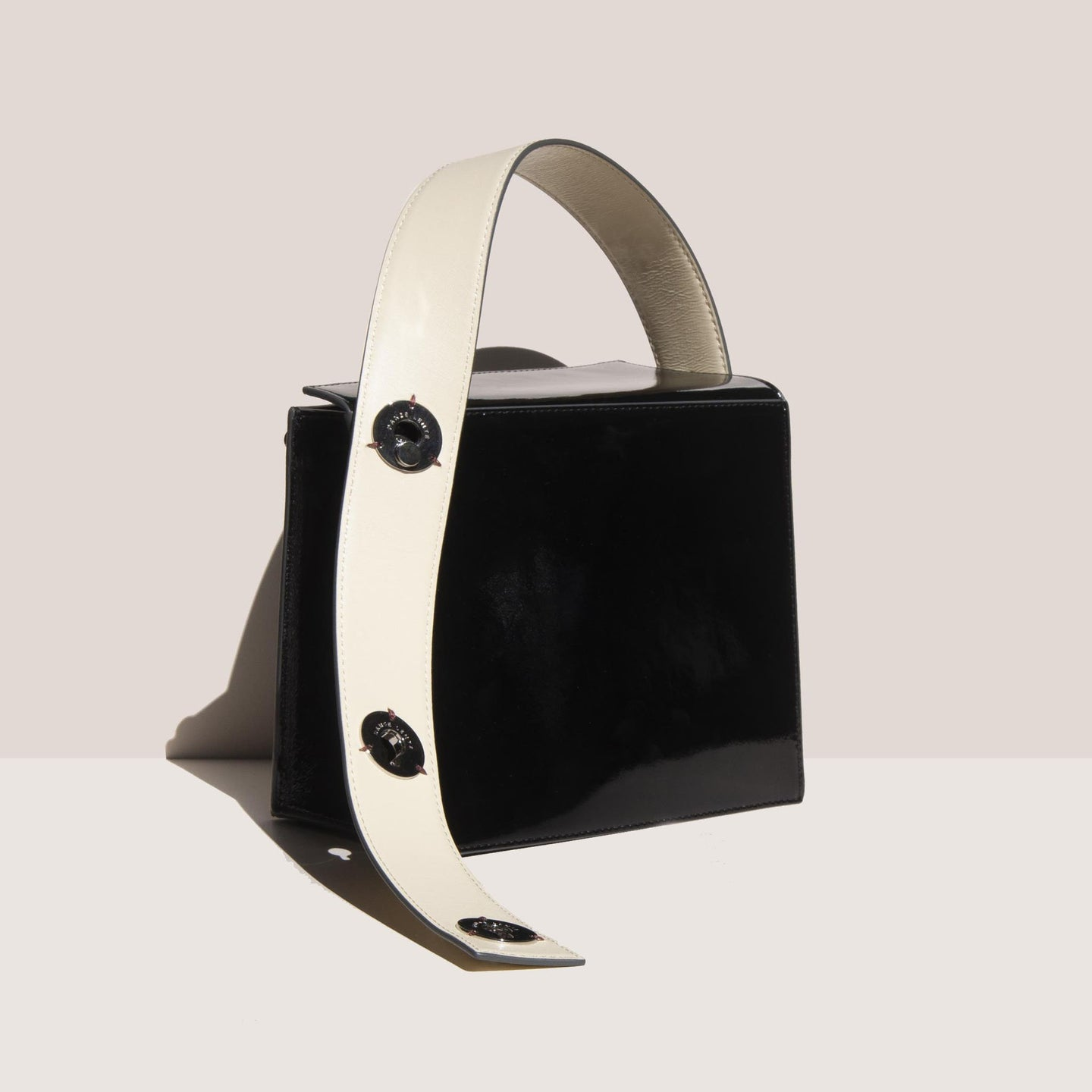Danse Lente - Zoe Bag - Black/Buttercream, angled view, available at LCD.