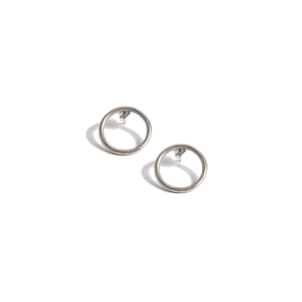 Silver circle ring stud earrings on white backdrop