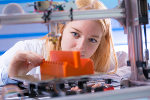 Lady inspecting her 3D Print