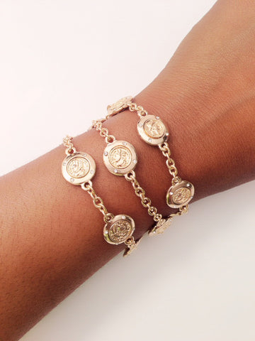 Gold Triple Chain Bracelet with Coin Detail