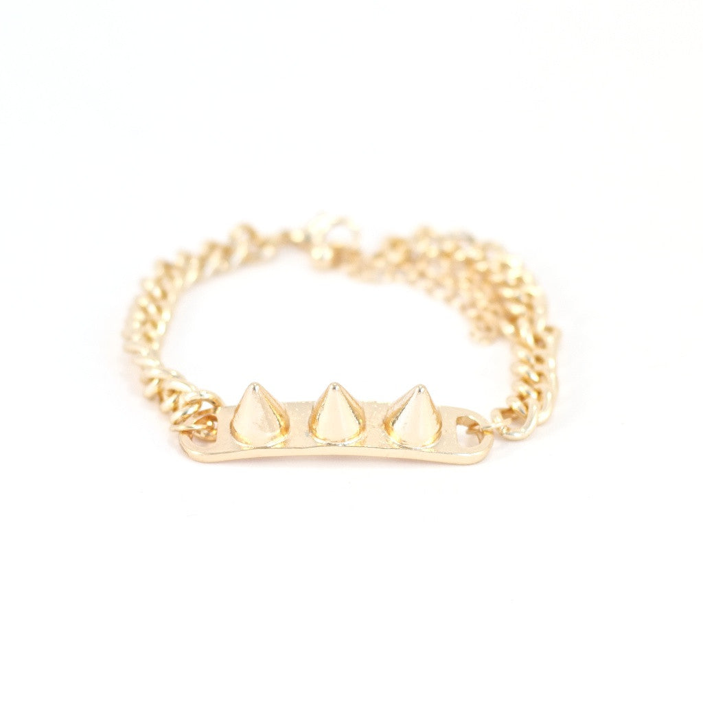 Three Spikes and You're Out Bracelet. Gold coloured metal, spike design.