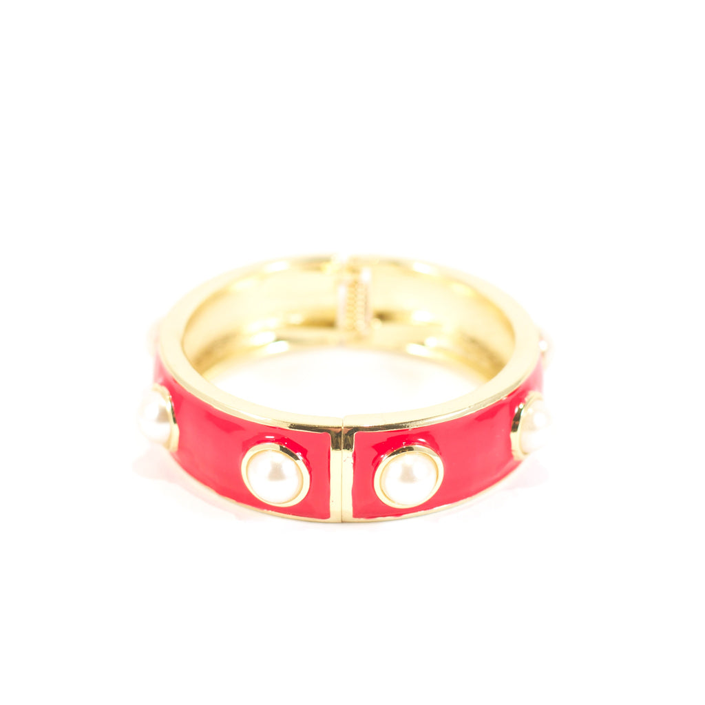 You Do Something To Me Bangle. Red and gold metal peal bangle.