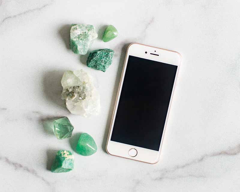 Phone and green crystals
