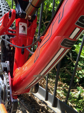 Clear Frame Protection on Intense red mountain bike