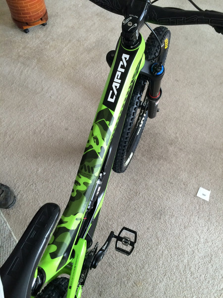 YT Capra in green with the translucent Camo Frame Guard on top