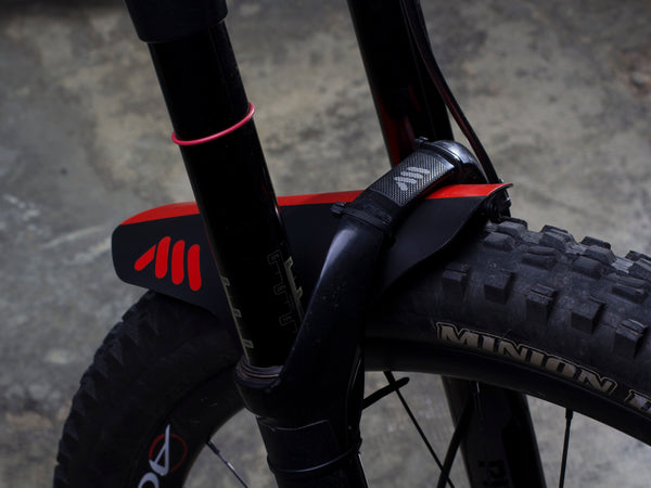 AMS Mud Guard in Red color on a mountain bike fork