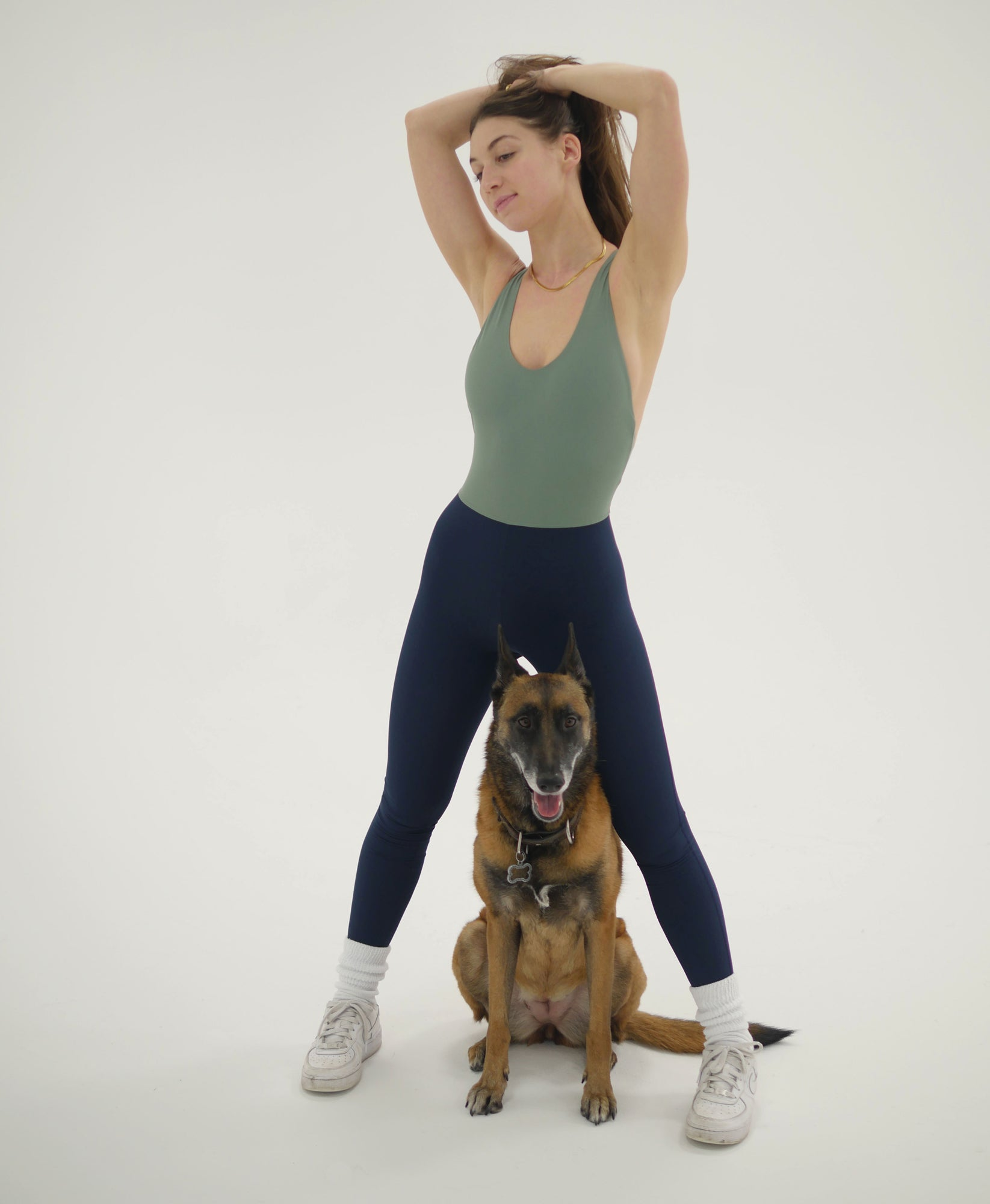Wear One's At Liberty Unitard in Sage and Navy on Model with Dog Full Front View
