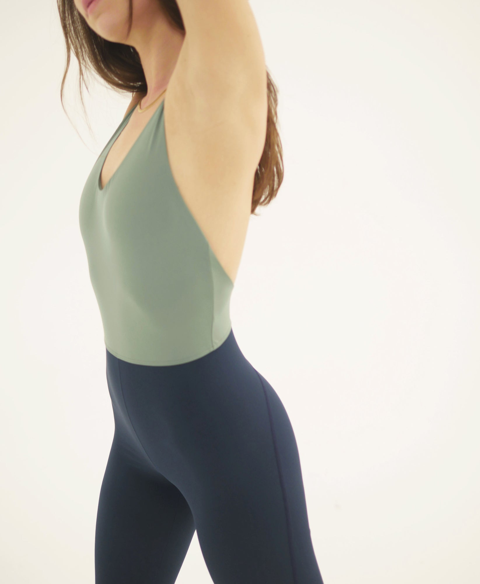 Wear One's At Liberty Unitard in Sage and Navy on Model Side Detail View
